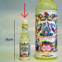 Een mini-flesje Florida water (Agua de Florida, een vinding uit Peru). Heeft een specifieke fris-bloemige geur.