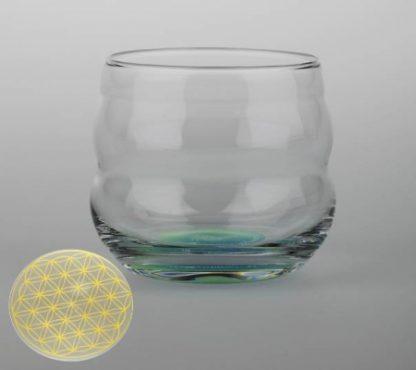 Drinkglas met op de bodem een gouden Flower of Life (bloem des levens)